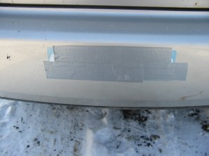Photo of taped over bumper sticker